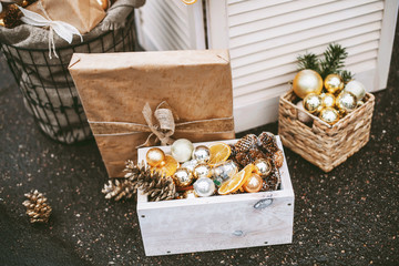 Christmas street decorations with cookies, cacao, handmade wooden table, little flags and baubles and a red brick wall