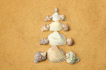 Christmas tree made of shells on the sand