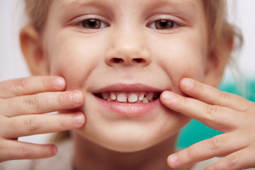 Cute little child with perfect toothy smile. Concept of teeth cure and cavity protection.