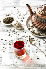 Turkish tea in traditional glass on wooden background