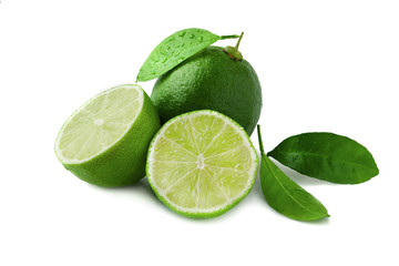 Fresh lime with leaf and water drops isolated on white