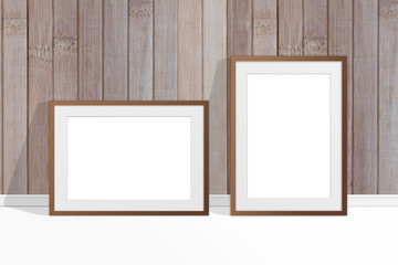 Two blank photo frames near wooden panels wall, rustic home style. interior decor mock up