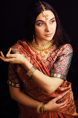 beauty sweet real indian girl in sari smiling on black background, lifestyle people concept