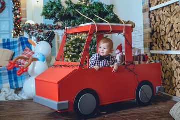 little kid near christmas tree