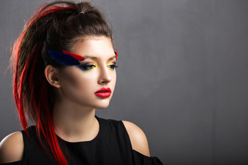 Beautiful girl.Professional makeup, red lips, photographed in St