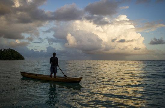 A man in a dug out canoe, Solomon Islands