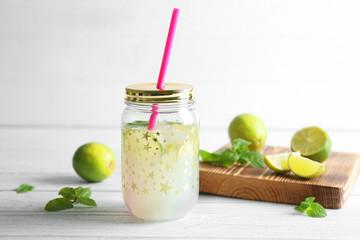 Lime lemonade in mason jar on wooden table