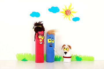 Young Happy Family and their Pet Walking Outdoors. Puppet Toys. Children theater. Handmade