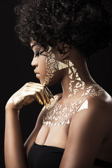 Afro-American model in gold