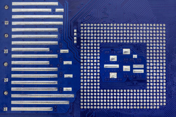 Technological background with blue computer motherboard closeup
