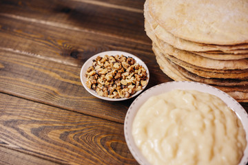 ingredients for baking homemade cake. shortcakes, buttercream or cream