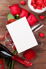 Red roses, champagne and greeting card