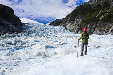 Woman standing on the ice of Fox Glacier, Westland Tai Poutini National Park, South Island, New Zealand, Pacific
