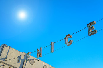 Venice Beach sign under a shining sun