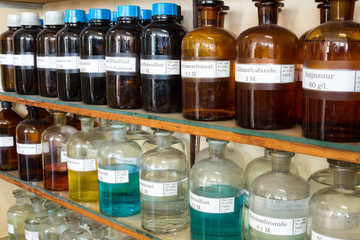 Rows of liquid chemicals in bottles at chemistry