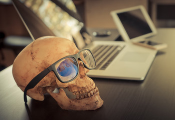 Dead Skull Corruption Business man on office table.