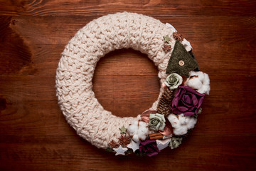 Christmas wreath on wooden background - Top view. Christmas decoration
