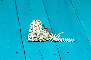 Wicker heart with the word Welcome