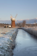 A frosty winter morning in the Norfolk Broads showing Horsey Mill, Horsey, Norfolk, England, United Kingdom, Europe