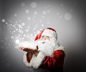 Santa Claus is blowing. Miracle concept.