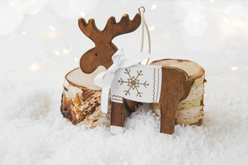 Christmas wooden reindeer ornament on snow