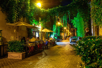 Night view of cozy street in Rome, Italy