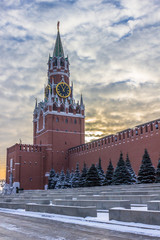 Spasskaya tower, wall of Moscow Kremlin and dramatic sky in winter morning. Moscow, Russia