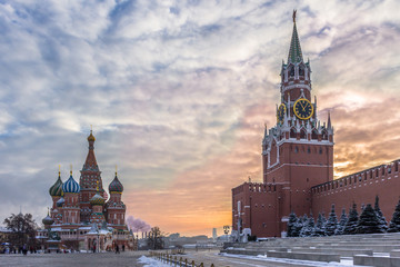 Saint Basil's Cathedral and Spasskaya tower in Red Square and colorful sky at winter morning. Moscow, Russia.