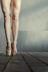 Skilled ballet dancer standing on the tiptoes in the studio
