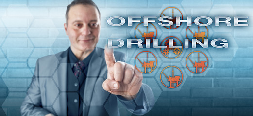 Happy Male Manager Touching OFFSHORE DRILLING