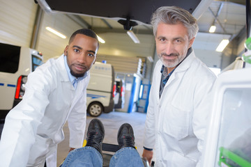 Portrait of two ambulance car workers