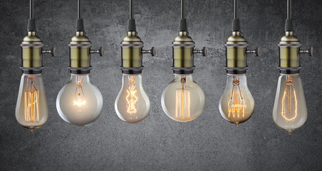 Vintage hanging light bulbs over grunge wall