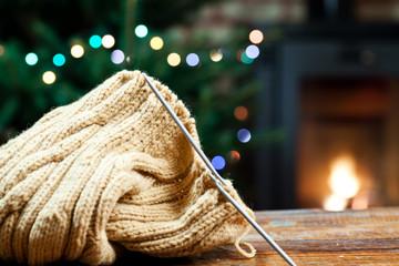woolen knitwear on red armchair