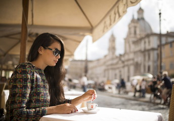 Young woman enjoying Espresso at restaurant, Piazza Navona, Rome, Lazio, Italy, Europe