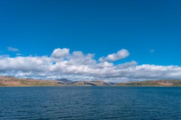 Clouds blue sky and Iceland in Atlantic ocean, summer