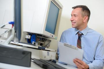 Man looking at computer monitor and smiling