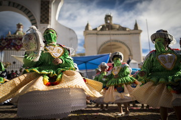 Dancers in traditional costume, Fiesta de la Virgen de la Candelaria, Copacabana, Lake Titicaca, Bolivia, South America