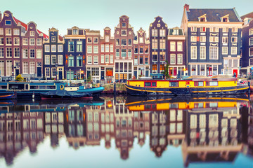 Fotobehang Amsterdam Amsterdam canal Singel with typical dutch houses and houseboats during morning blue hour, Holland, Netherlands. Used toning