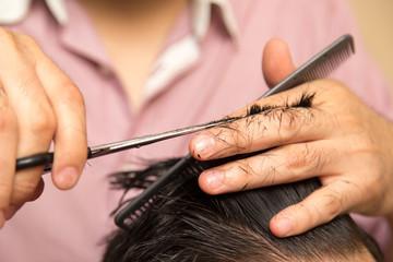 men's haircut with scissors at salon