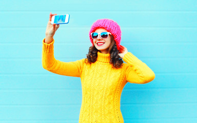 Fashion happy smiling young woman taking picture self portrait o