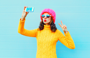 Fashion young woman taking picture self portrait on smartphone o