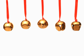 Five Jingle Bells hanging from red ribbons