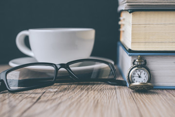 Pocket Watch and Coffee Cup with Book  and The Glasses on Wooden