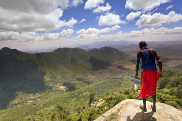 Samburu man looks down over the Ewaso Rongai Valley from Mount Nyiru, Northern Frontier, Kenya, East Africa, Africa