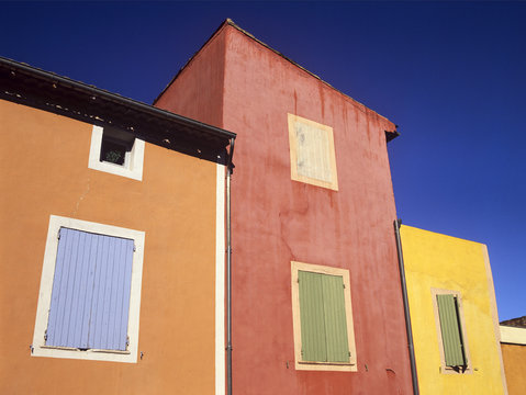 Ochre tinted houses in the colourful village of Roussillon, Provence, France
