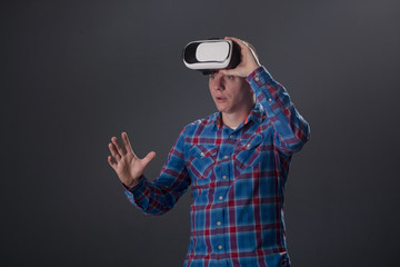 cyberspace and people concept -  man with virtual reality headse