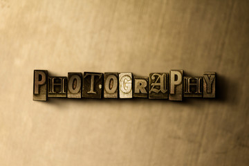 PHOTOGRAPHY - close-up of grungy vintage typeset word on metal backdrop. Royalty free stock illustration.  Can be used for online banner ads and direct mail.