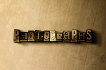 PHOTOGRAPHS - close-up of grungy vintage typeset word on metal backdrop. Royalty free stock illustration.  Can be used for online banner ads and direct mail.