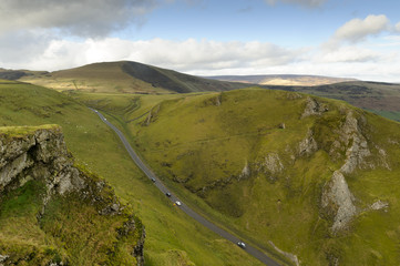 Cars travelling down Winnats Pass, Castleton, Peak District National Park, Derbyshire, England, United Kingdom, Europe