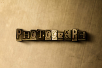 PHOTOGRAPH - close-up of grungy vintage typeset word on metal backdrop. Royalty free stock illustration.  Can be used for online banner ads and direct mail.